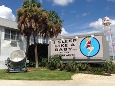 Pinup billboard, searchlight, palm