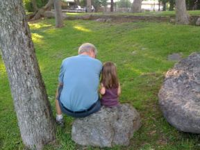 Sitting on a Rock with Granddaughter
